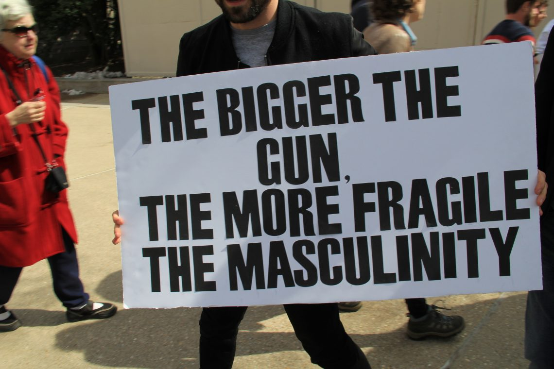 "March for Our Lives Washington DC 2018 - Signs and Marchers. ""The bigger the gun, the more fragile the masculinity."" Photo Ziggyfan23 / Wikimedia Commons"
